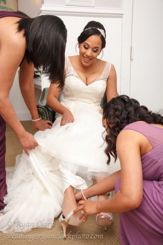 Helping The Bride With Her Shoes